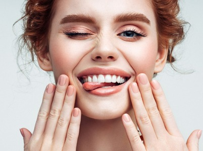 Ginger woman showing her teeth