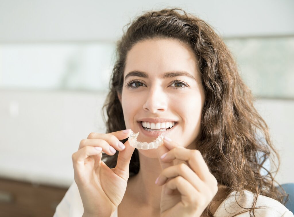 Woman with Invisalign teeth straightening tray